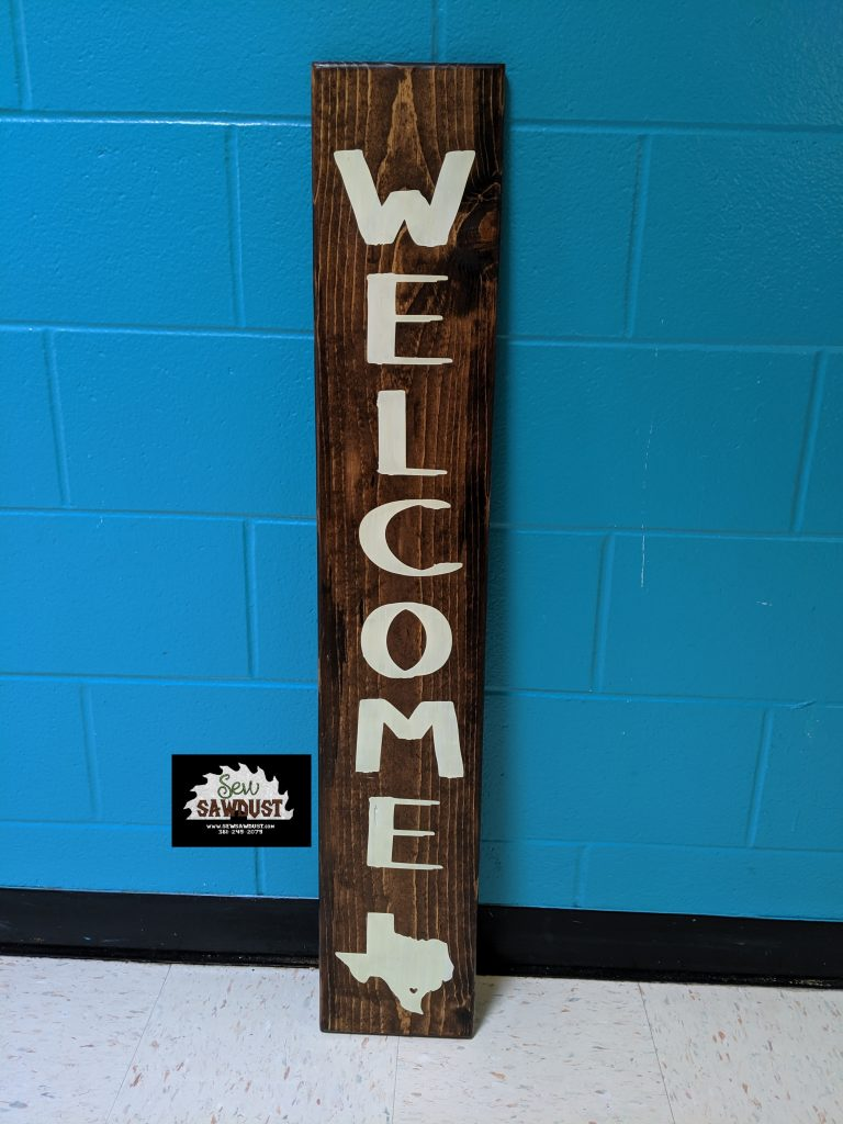 This short welcome patio sign has routered edges and is 4 ft tall. Made by sew sawdust