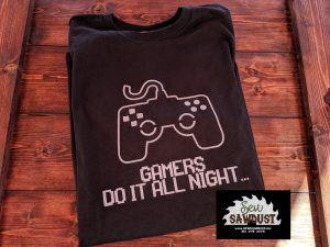 """Black shirt with """"Gamers do it all night"""" vinyl'd in white, with a game controller. Made by Sew Sawdust"""